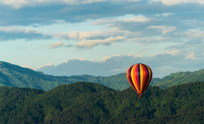 Colorfull Hot air balloon in mountain stock images