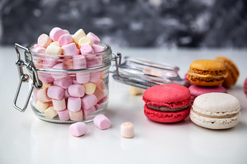 Colorful macaroons with marshmallows stock image