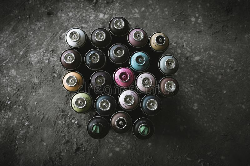 Graffiti Spray Cans On Dirty Floor royalty free stock photography