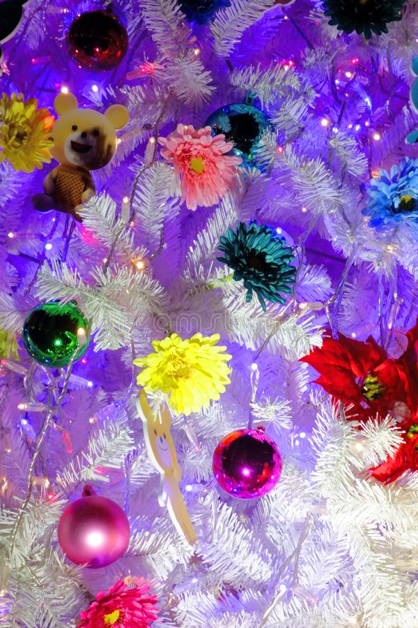 Colorfully decorated tree. A colorfully and colorfully decorated tree royalty free stock photo