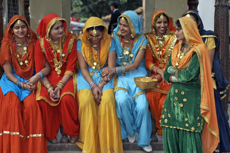 Colorfully Dressed Indian Women. Group of colorfully dressed Indian ladies at the annual Surajkund Mela near Delhi, India royalty free stock photography
