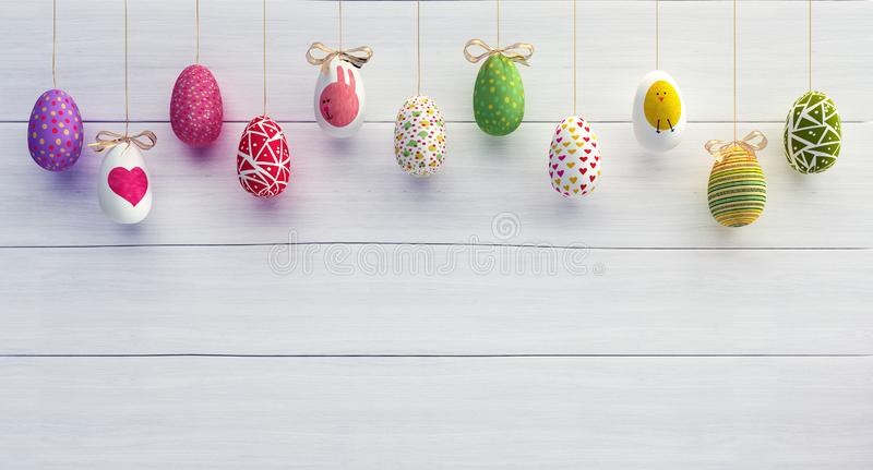Colorfully Easter eggs on white wood background. 3D Rendering stock photography