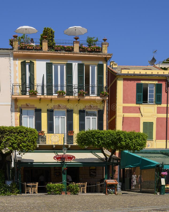 Colorfully painted buildings and pizza restaurant in Portofino. Pictured are colorfully painted buildings and a pizza restaurant in Portofino, an Italian fishing stock photography