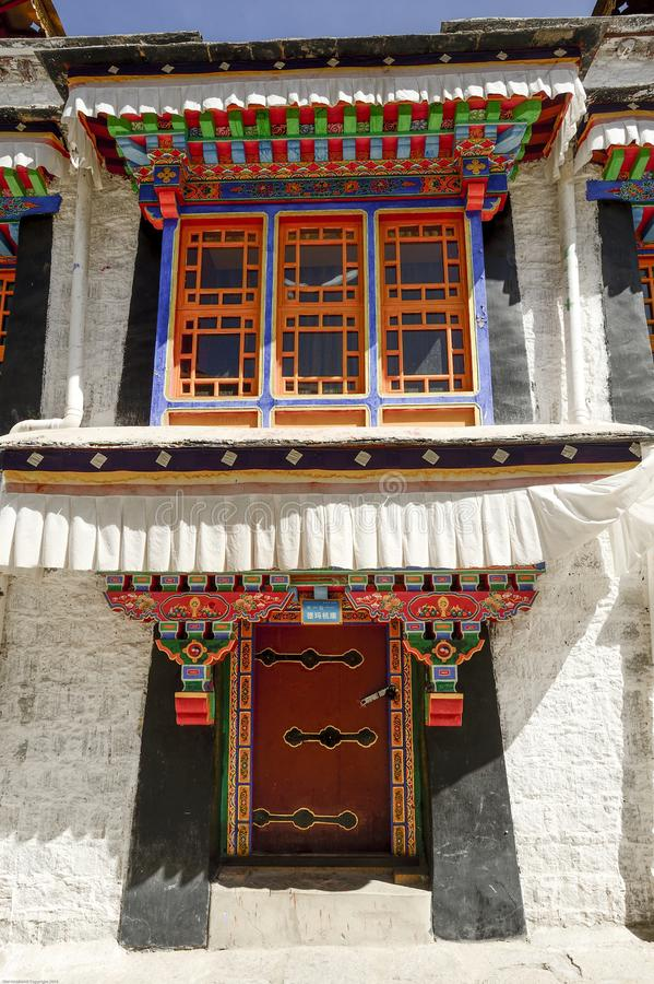 A colorfully painted door and window adorn Deprung Monastery. A colorfully painted door and window adorn Deprung Monastery in Lhasa, Tibet stock images