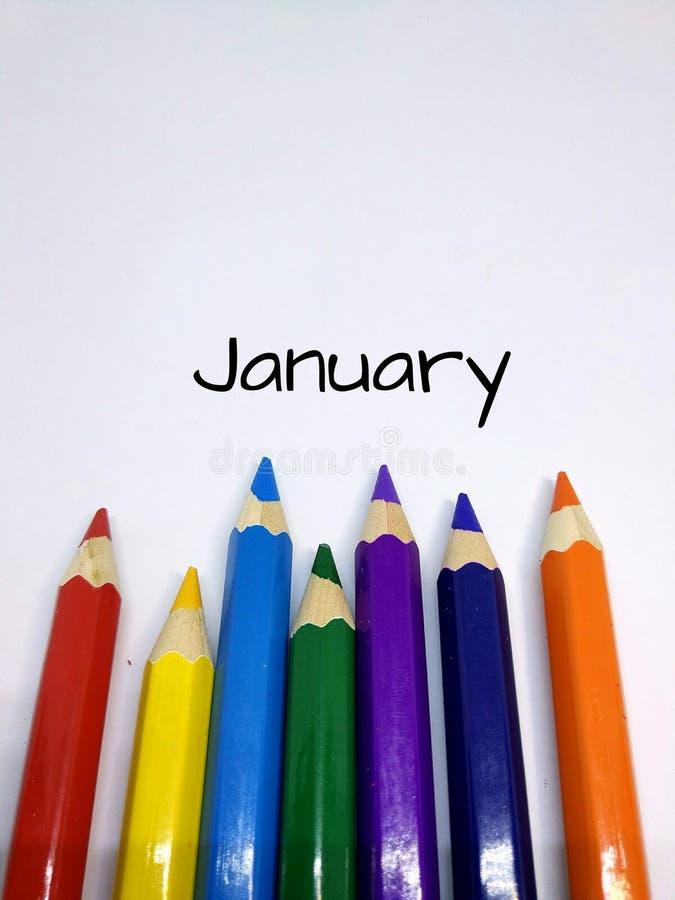 Colori Colourful della matita con il concetto di mese per gennaio fotografia stock