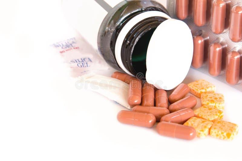 Colorido de medicaciones orales en el fondo, las drogas o las píldoras blancas fotos de archivo