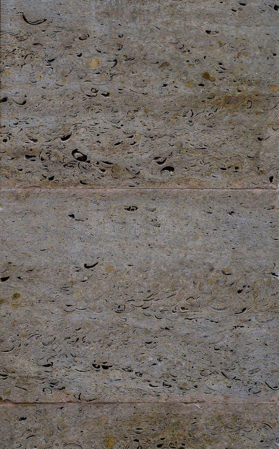 Colorido una piedra caliza con muchos diversos colores tiene gusto el marrón blanco, marrón claro, oscuro y mucho otro imagen de archivo
