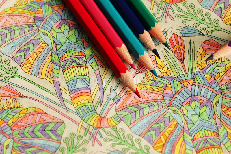 The coloring book with pencils. The coloring book for adults hobby with pencils stock photos