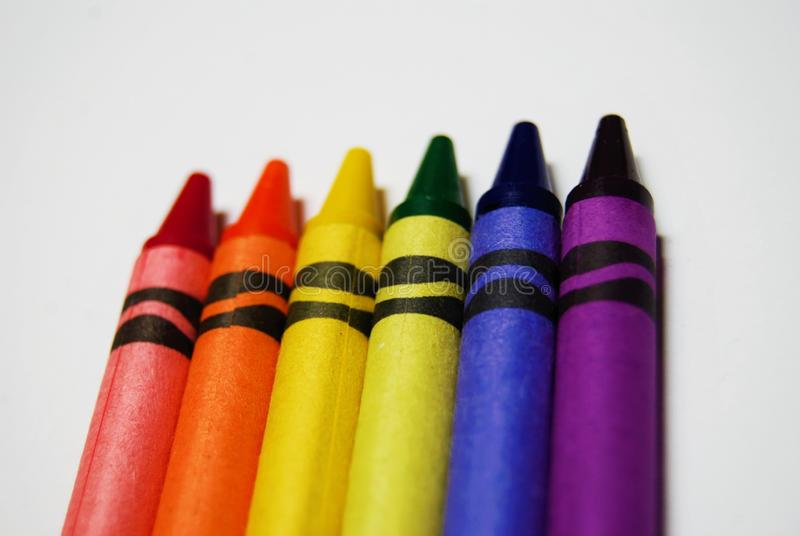 Coloring crayons arranged on a white background stock photography