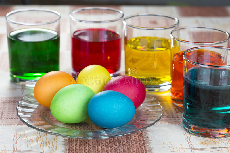Coloring eggs for Easter holiday. Coloring eggs in bright colors for Easter holiday royalty free stock photography