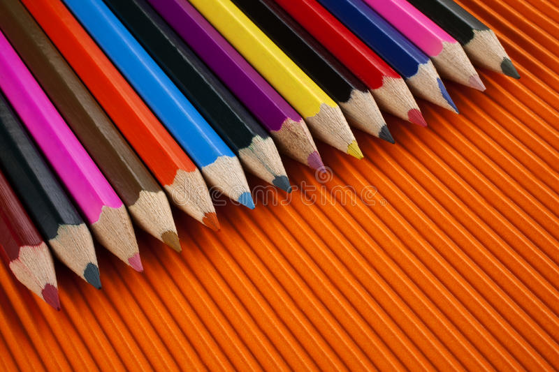Coloring pencils. Top view diagonally on an orange background landscape royalty free stock image