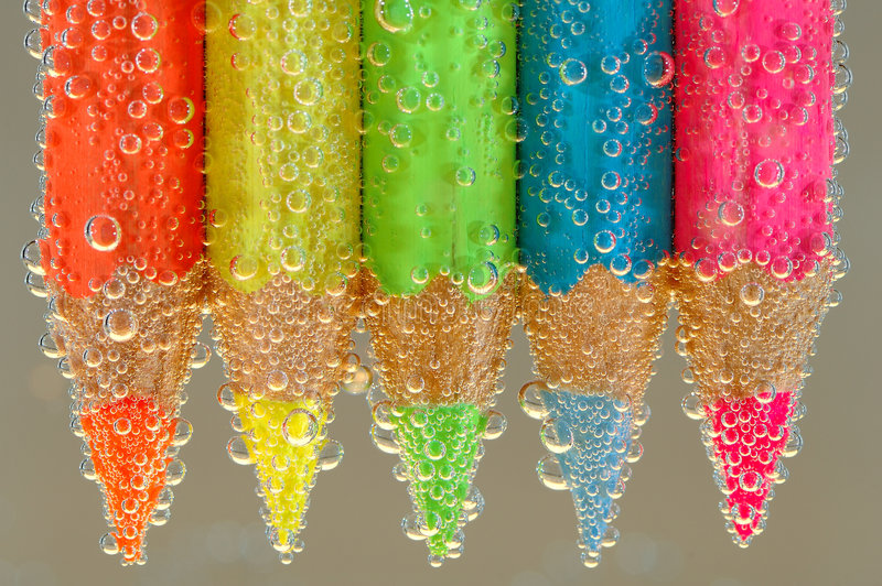 Coloring pencils in water stock image