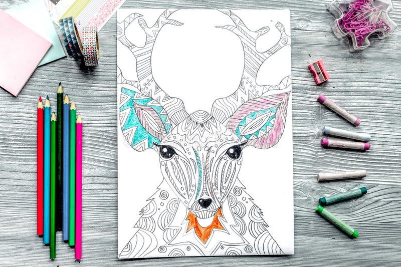 Coloring picture for adults on wooden background top view.  royalty free illustration