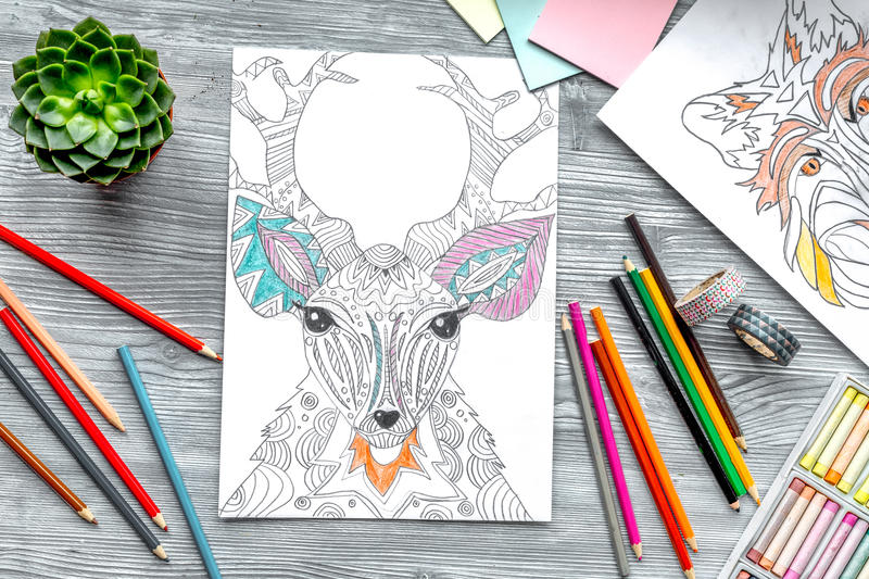 Coloring picture for adults on wooden background top view.  stock illustration