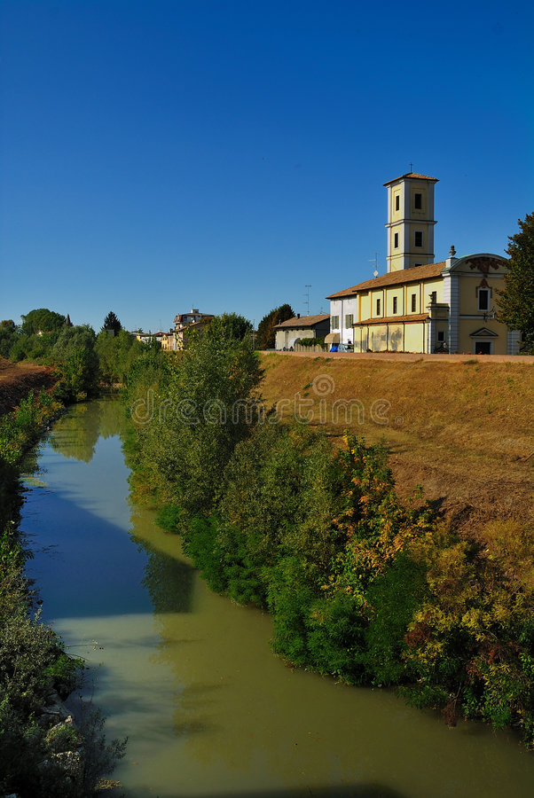 Colorno commune and river. Scenic view of river with Colorno commune in background, Parma province, Emilia-Romagna region, Italy stock photo