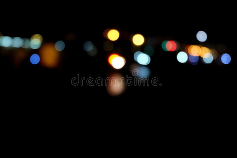 Colors bokeh in black background stock photography