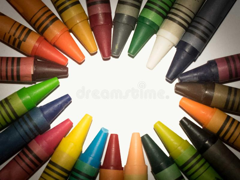 Colors on a circle, abstract. Round colorful crayons, wax crayons isolated on white background stock photography