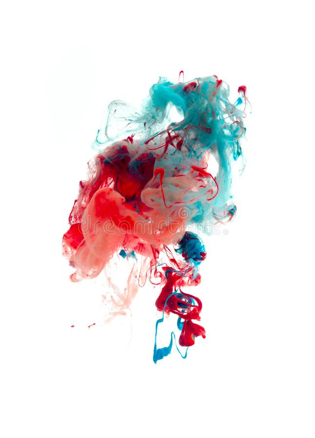 Colors dropped into liquid and photographed while in motion. Cloud of silky ink in water on white isolated stock images