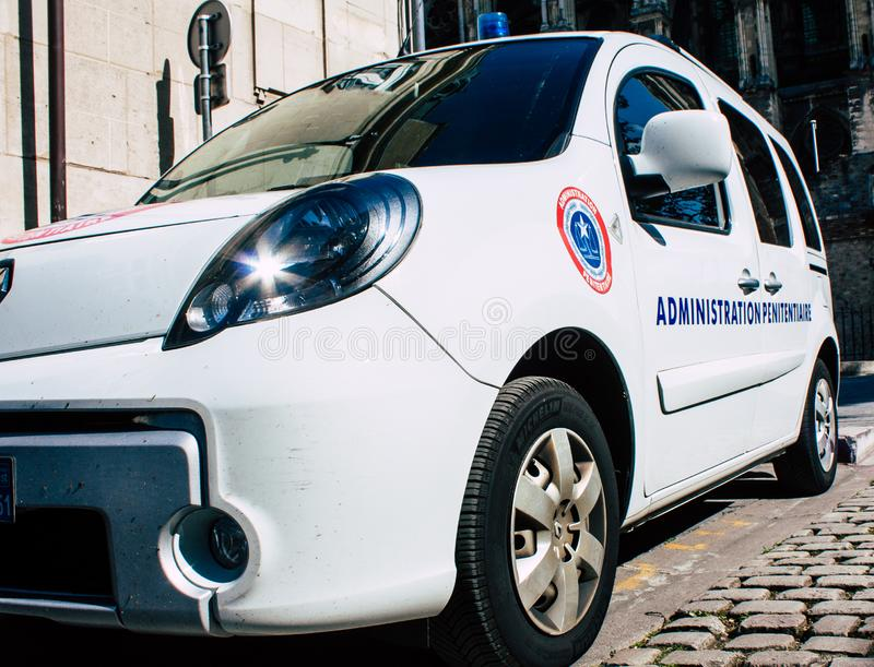 Colors of France. Reims France April 21, 2019 Closeup of a white police car of the penitentiary administration parked front the tribunal of Reims in the stock photography