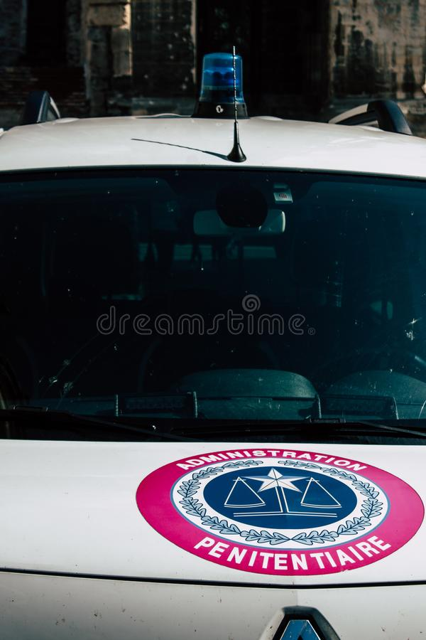 Colors of France. Reims France April 21, 2019 Closeup of a white police car of the penitentiary administration parked front the tribunal of Reims in the royalty free stock photography