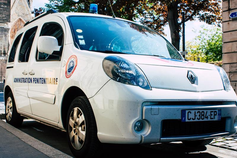 Colors of France. Reims France April 21, 2019 Closeup of a white police car of the penitentiary administration parked front the tribunal of Reims in the stock image