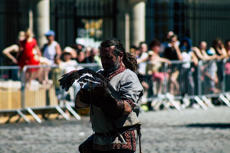 Colors of France. Reims France June 2, 2019 Closeup of a falconer and a raptor participating in a falconry show in the streets of Reims in the afternoon stock images