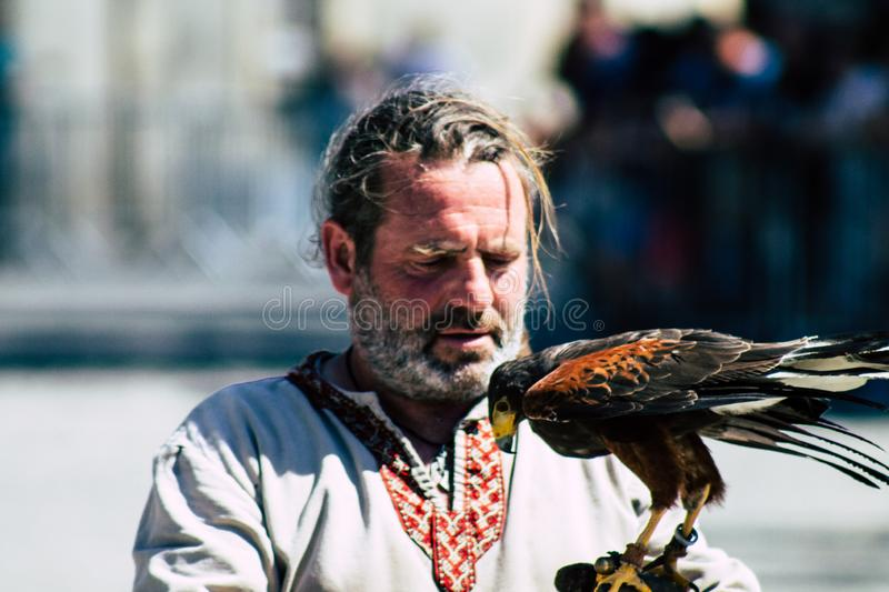 Colors of France. Reims France June 2, 2019 Closeup of a falconer and a raptor participating in a falconry show in the streets of Reims in the afternoon royalty free stock photos