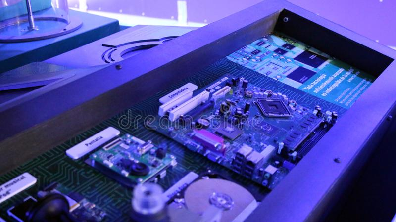 Colors of Hardware. Circuit technology board lighted by blue colors you can see sensors and microchips using a microscope royalty free stock image