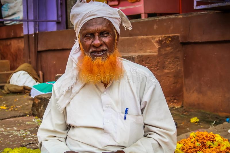Colors of India. Gokarna Karnataka India November 01, 2017 Portrait of unknown people selling flowers in the street of Gokarna town, in the eveningn royalty free stock photography
