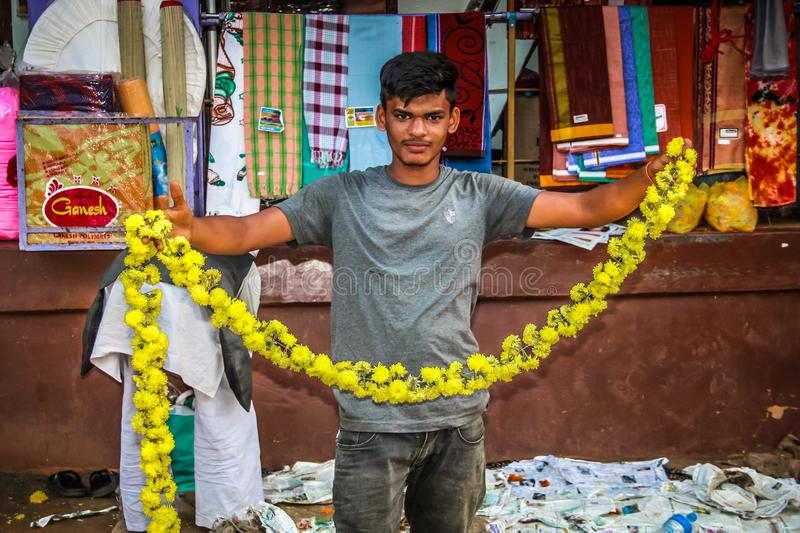 Colors of India. Gokarna Karnataka India November 01, 2017 Portrait of unknown people selling flowers in the street of Gokarna town, in the eveningn stock photography