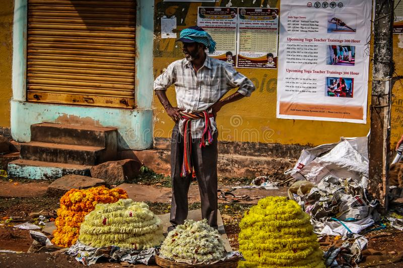 Colors of India. Gokarna Karnataka India November 01, 2017 Portrait of unknown people selling flowers in the street of Gokarna town, in the eveningn stock image