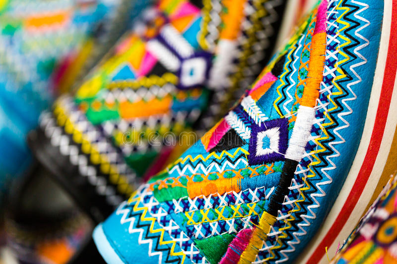 Colors of Marrakesh on sophisticated handmade slippers at medina royalty free stock photo