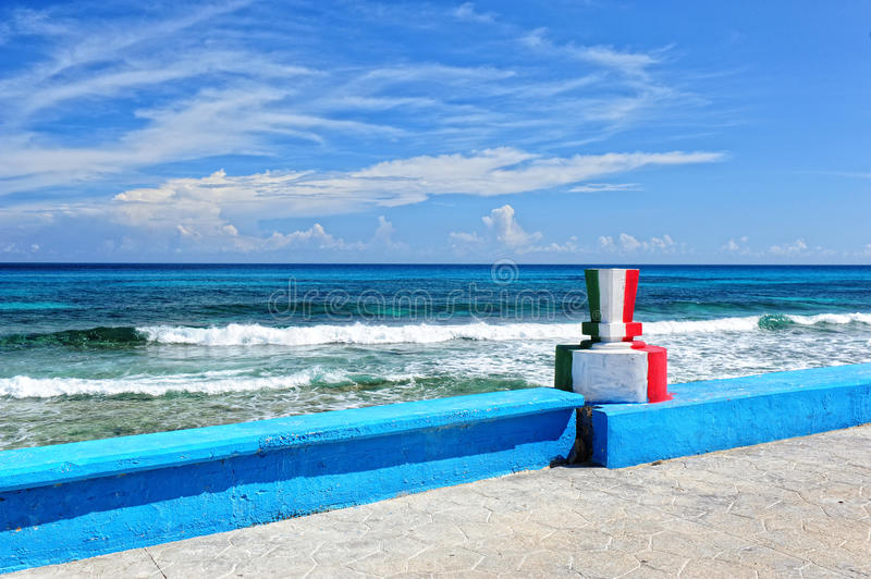 Colors of Mexican flag on the monument. On the road in Isla Mujeres royalty free stock photo