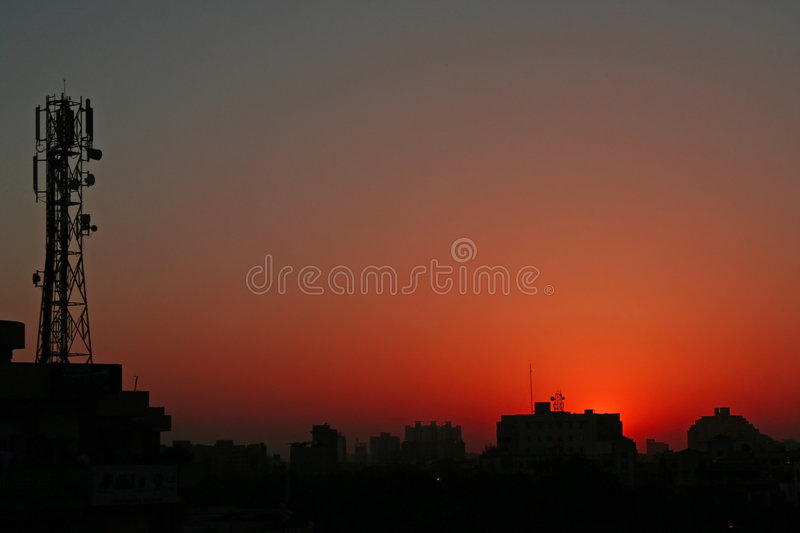 Download Colors Of Nature And  Silhouetted  Towers In Skies Stock Photo - Image: 630158