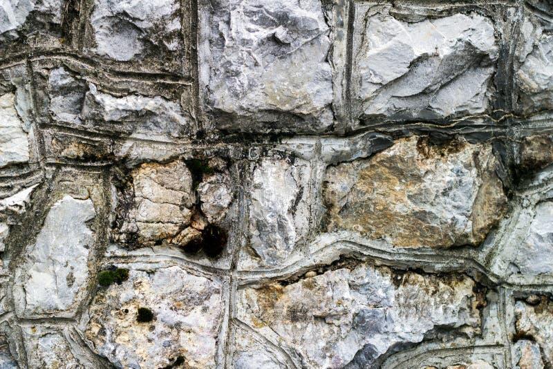 colors olikt seamless stonewall textur arkivfoton