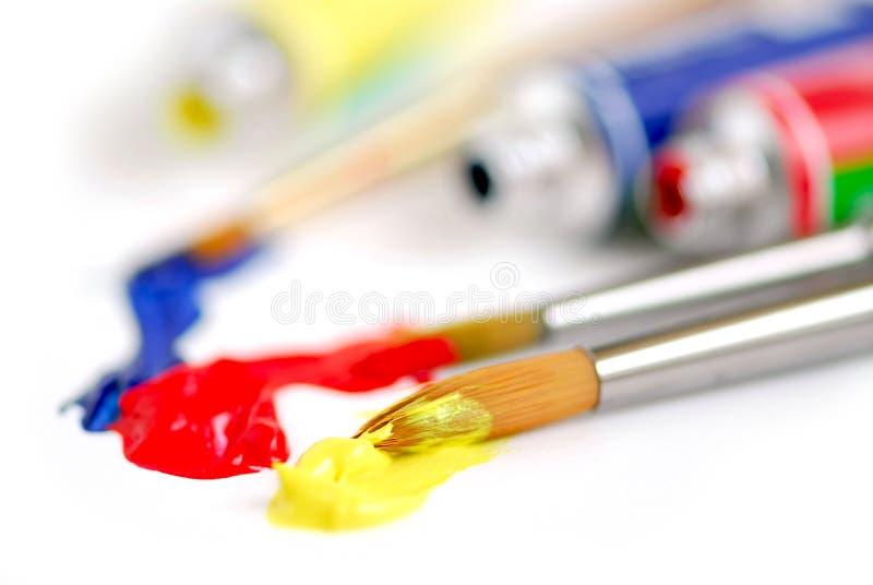 colors paintbrushen huvud arkivfoto