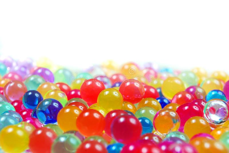 Colors of rainbow. Multicolored hydrogel balls texture background. top view. Color conceptl. Colors of rainbow. Multicolored hydrogel balls texture background stock photography