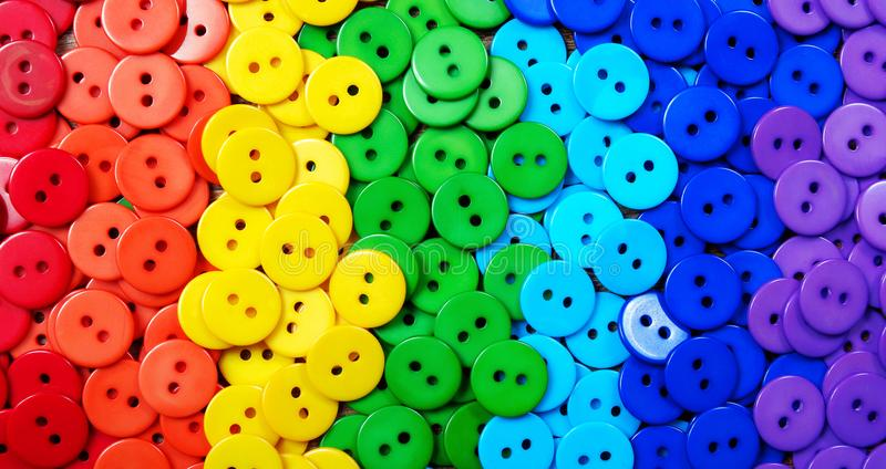 Colors of rainbow. Pattern of multicolored buttons texture background. Palette of rainbow colors royalty free stock photo