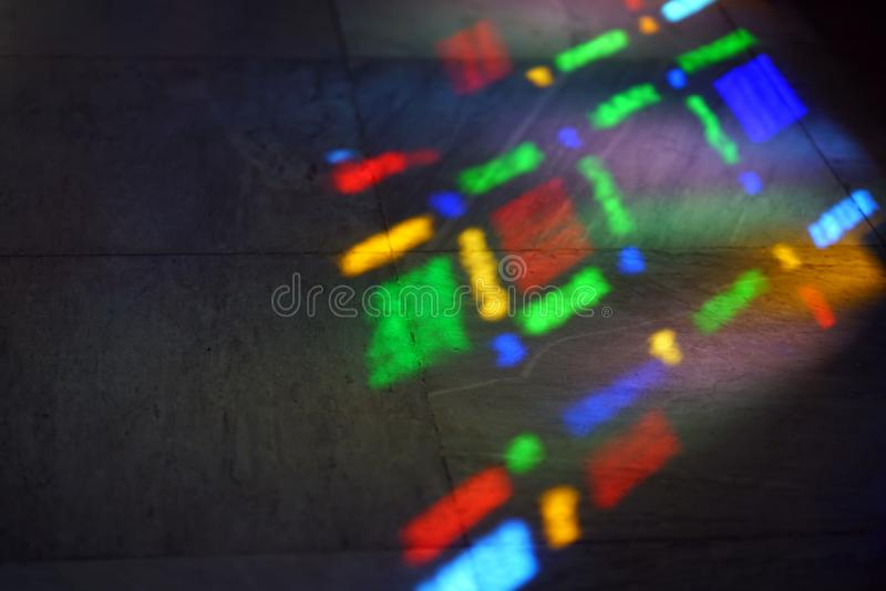 Colors of a stained glass window reflected on the floor royalty free stock photo