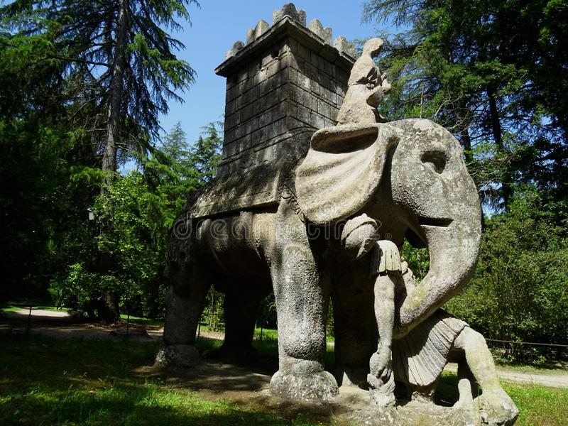 Colossal statue in the forest of Bomarzo. Italy. Colossal Mannerist Renaissance statue of Elephant and Castle. 16th Century. Lacio. Bomarzo. Italy stock photo