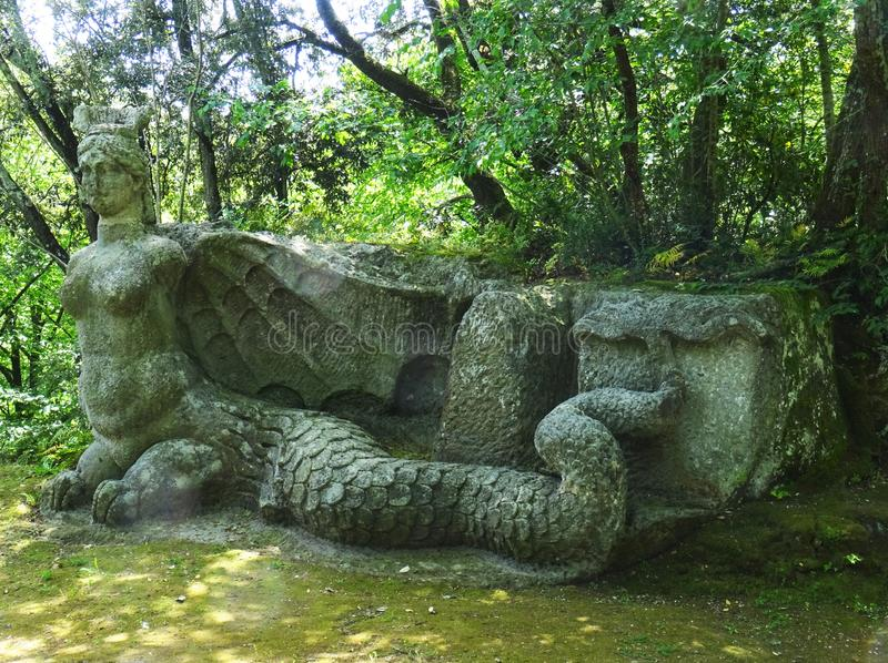 Colossal statue in the forest of Bomarzo. Italy. Colossal Mannerist Renaissance statue of Furia. 16th Century. Lacio. Bomarzo. Italy, ancient, antique, arpia stock images