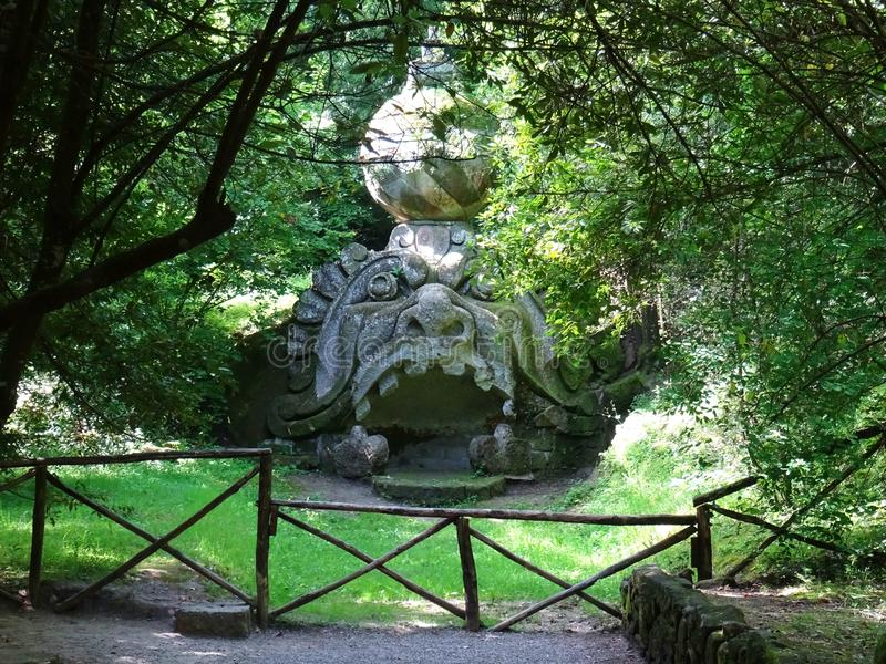 Colossal statue in the forest of Bomarzo. Italy. Colossal Mannerist Renaisance statue of Head of Proteus. 16th Century. Bomarzo. Lacio. Italy stock image