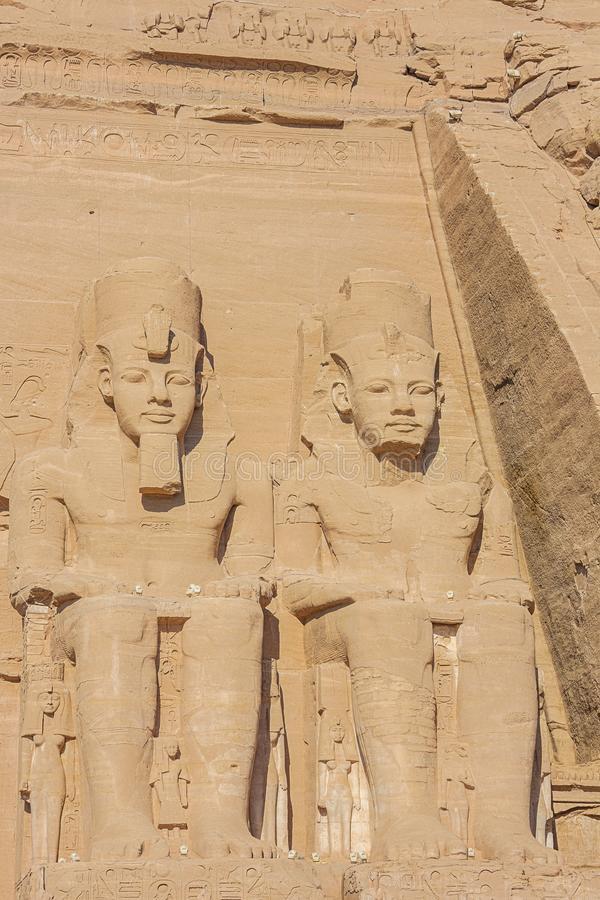 The colossal statues of Ramesses II. And the smaller statues of conquered enemies royalty free stock photography