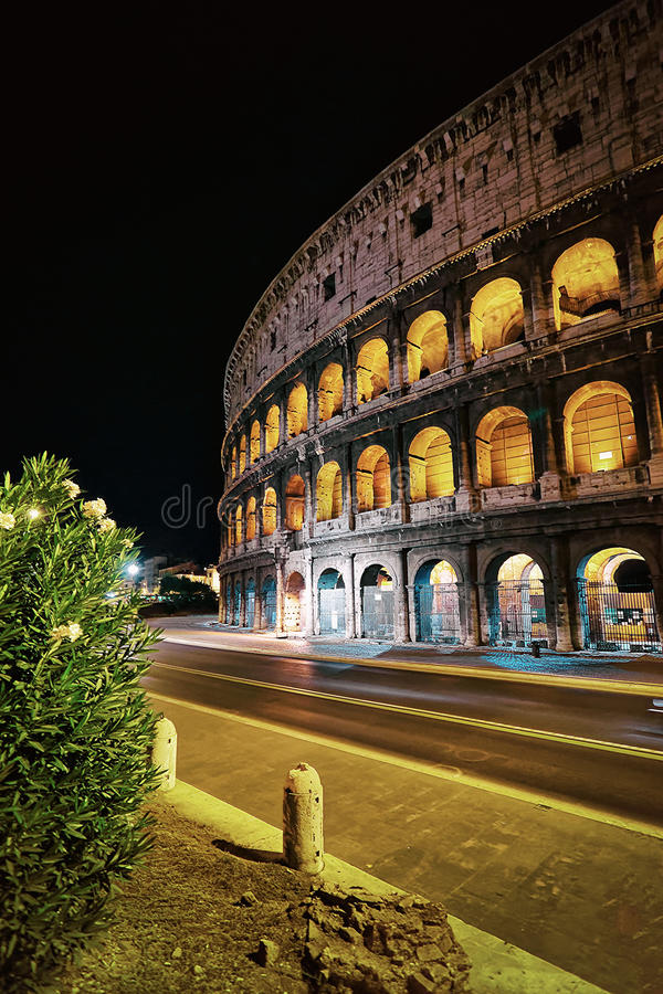 Colosseum in the city center of Rome Italy at dusk royalty free stock image
