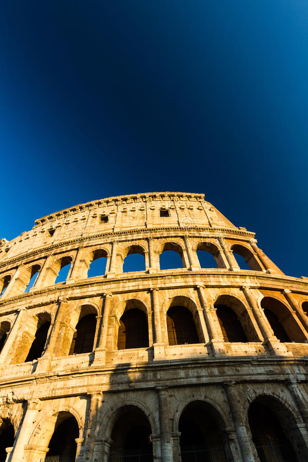 Colosseum or Coliseum Amphitheatre, evening in Rome. The Colosseum or Coliseum Roman Amphitheatre in late afternoon or evening royalty free stock photo