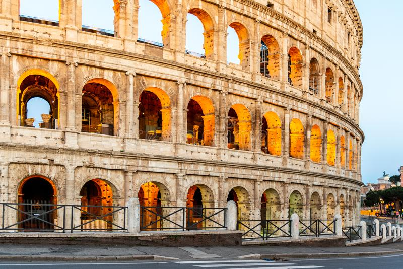 Colosseum, or Coliseum. Illuminated huge Roman amphitheatre early in the morning, Rome, Italy royalty free stock photos