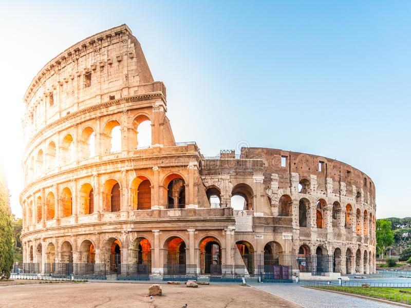 Colosseum, or Coliseum. Morning sunrise at huge Roman amphitheatre, Rome, Italy. stock images