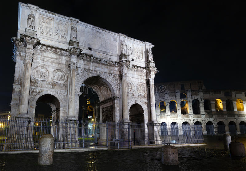 Colosseum and Constantine Arch night view, Rome. royalty free stock photography