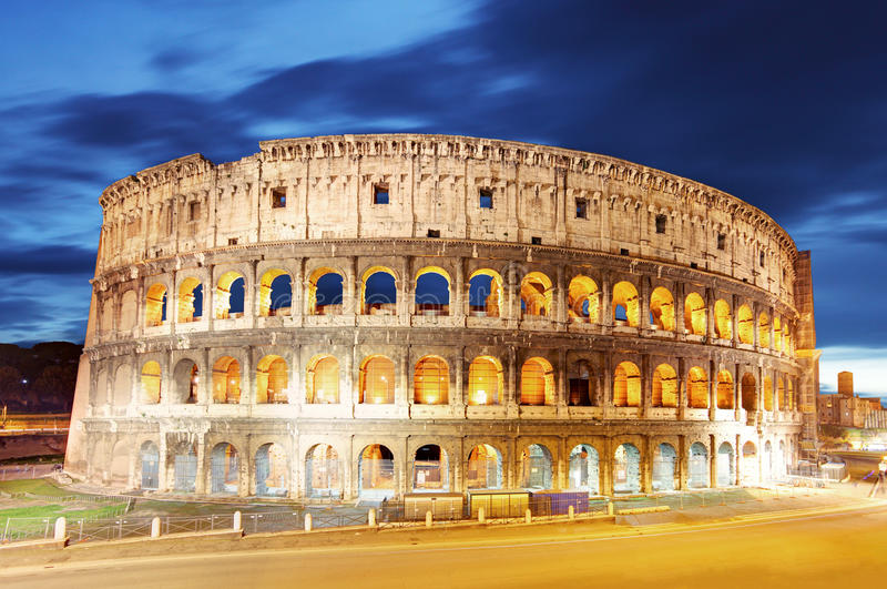 Colosseum at dusk in Rome, Italy stock photography