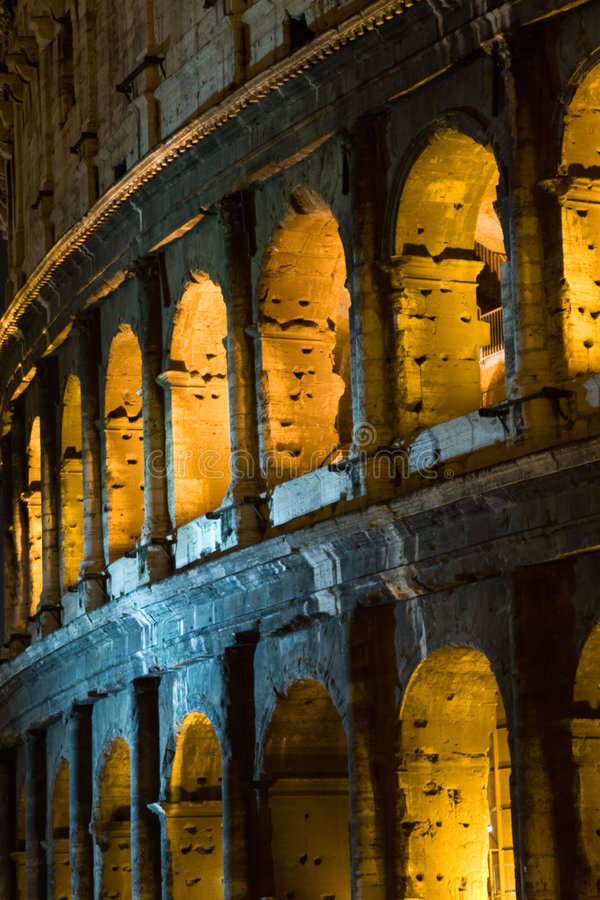 Colosseum by night. The Colosseum illuminated at nighttime stock photos